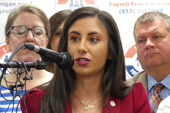 """In this Aug. 29, 2019 photo, Democratic State Rep. Mari Manoogian speaks in Lansing, Mich. Third-term Rep. Steve Marino, a Republican, issued a statement Thursday, Sept. 16, 2021, a day after second-term Democratic Rep. Mari Manoogian said his removal from two committees stemmed from their """"volatile"""" relationship. She said she was taking steps to ensure her safety following domestic abuse, including threats of public shaming. (AP Photo/David Eggert)"""