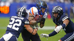 BYU defensive back Ammon Hannemann (22) tackles Boise State wide receiver Khalil Shakir, center, in the first half during an NCAA college football game Saturday, Oct. 9, 2021, in P,rovo, Utah. (AP Photo/Rick Bowmer)