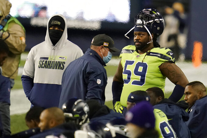 Seattle Seahawks defensive tackle Damon Harrison (59) stands on the sideline during the first half of an NFL football game against the Arizona Cardinals, Thursday, Nov. 19, 2020, in Seattle. (AP Photo/Elaine Thompson)