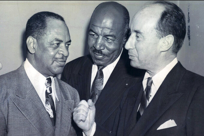 """From left, Rep. William Dawson, Cook County Municipal Court judge candidate Frederick """"Duke"""" Slater and Adlai Stevenson, candidate for governor, are shown in this Oct. 31, 1948, photo. Slater was the NFL's first African-American lineman, and often the only Black player on the field. After retiring, he broke down more racial barriers to become a judge in Chicago. (Chicago Sun-Times via AP)"""