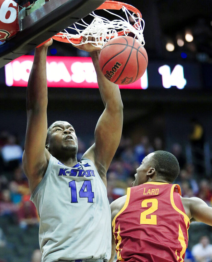 Kansas State forward Makol Mawien (14) dunks over Iowa State forward Cameron Lard (2) during the first half of an NCAA college basketball game in the semifinals of the Big 12 Conference tournament in Kansas City, Mo., Friday, March 15, 2019. (AP Photo/Orlin Wagner)