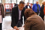 Kentucky Governor and Republican gubernatorial candidate Matt Bevin signs in to receive his ballot to cast his ballot in the state's general election in Louisville, Ky., Tuesday, Nov. 5, 2019. (AP Photo/Timothy D. Easley)