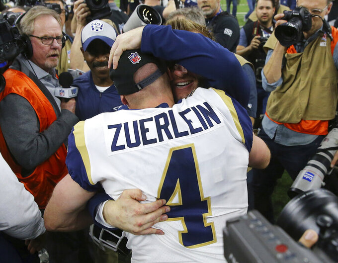 Los Angeles Rams head coach Sean McVay celebrates with Greg Zuerlein after a game-winning field goal during overtime of the NFL football NFC championship game against the New Orleans Saints Sunday, Jan. 20, 2019, in New Orleans. The Rams won 26-23. (AP Photo/Gerald Herbert)