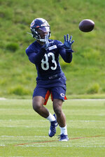 Chicago Bears wide receiver Dazz Newsome (83) catches a pass during the NFL football team's rookie minicamp Friday, May, 14, 2021, in Lake Forest Ill. (AP Photo/David Banks, Pool)