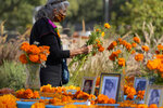 Artist and altar maker Ofelia Esparza, 88, from East Los Angeles, brings fresh marigolds for her community altar for Day of the Dead, titled