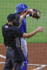 Home plate umpire Kaleb Devier calls a strike during a Low A Southeast League baseball game between the Dunedin Blue Jays and the Tampa Tarpons at George M. Steinbrenner Field Tuesday, May 4, 2021, in Tampa, Fla. The game is one of the first in the league to use automatic balls and strike calls. (AP Photo/Chris O'Meara)