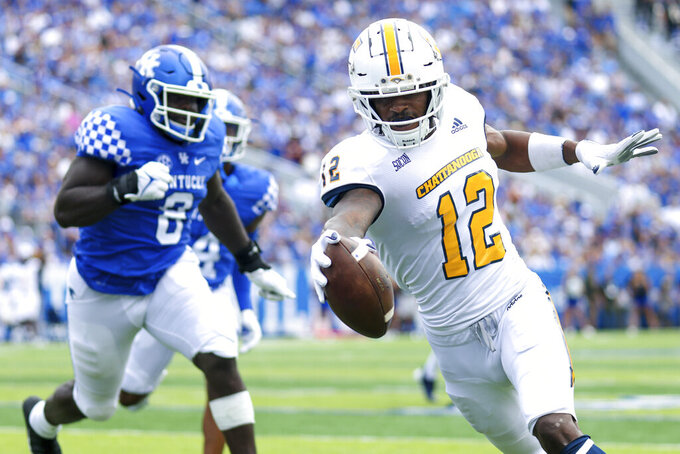 Chattanooga wide receiver Reginald Henderson (12) runs the ball into the end zone during the first half of a NCAA college football game against Kentucky in Lexington, Ky., Saturday, Sept. 18, 2021. (AP Photo/Michael Clubb)