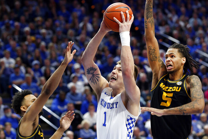 Kentucky's Nate Sestina, middle, shoots between Missouri's Torrence Watson, left, and Mitchell Smith (5) during the second half of an NCAA college basketball game in Lexington, Ky., Saturday, Jan 4, 2020. Kentucky won 71-59. (AP Photo/James Crisp)