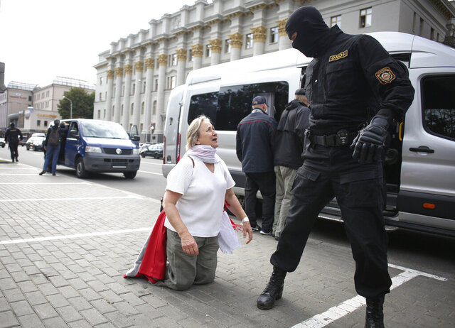 A woman argues with a policeman during a protest in Minsk, Belarus, Tuesday, Sept. 1, 2020. Several hundred students on Tuesday gathered in Minsk and marched through the city center, demanding the resignation of the country's authoritarian leader after an election the opposition denounced as rigged. Many have been detained as police moved to break up the crowds. (Tut.By via AP)
