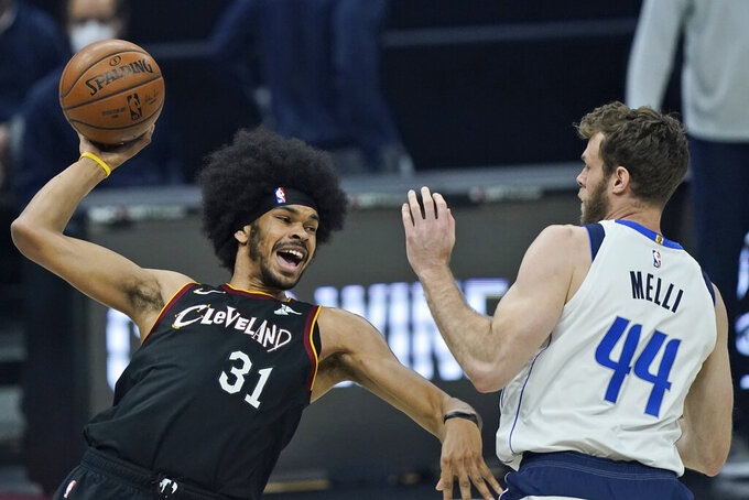 FILE - In this May 9, 2021, file photo, Cleveland Cavaliers' Jarrett Allen (31) tries to pass the ball against Dallas Mavericks' Nicolo Melli (44) in the first half of an NBA basketball game in Cleveland. The Cavaliers signed Allen to a five-year, $100 million contract on Friday, Aug. 6, 2021, securing the 23-year-old center as one of their foundational players. Allen, who came over in a mid-season deal from Brooklyn, was a restricted free agent before coming to terms with Cleveland earlier this week. (AP Photo/Tony Dejak, File)