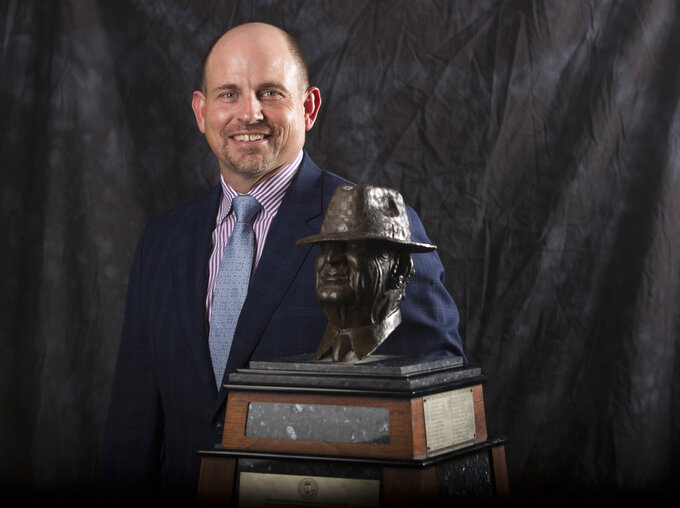 "UAB coach Bill Clark poses for a photograph with the Paul ""Bear"" Bryant Coach of the Year Award, before the ceremony Wednesday, Jan. 9, 2019, in Houston. (Yi-Chin Lee/Houston Chronicle via AP)"
