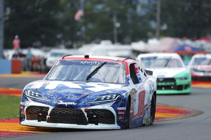 Kyle Busch (18) leads eventual winner Austin Cindric early in the NASCAR Xfinity Series auto race at Watkins Glen International, Saturday, Aug. 3, 2019, in Watkins Glen, N.Y (AP Photo/John Munson)
