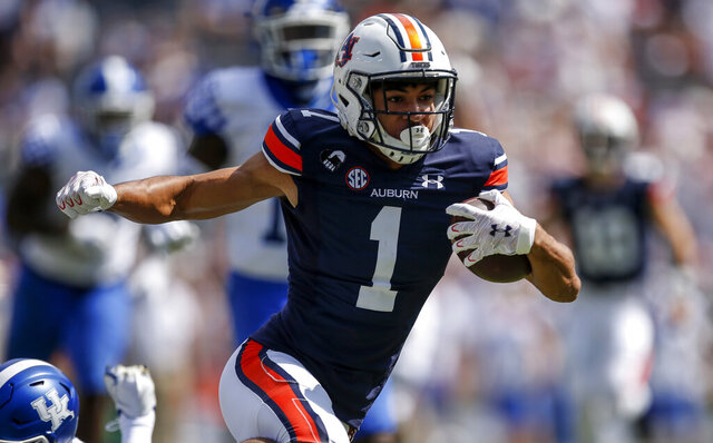 Auburn wide receiver Anthony Schwartz (1) catches a pass against Kentucky and carries for a first down during the first quarter of an NCAA college football game on Saturday, Sept. 26, 2020 in Auburn, Ala. (AP Photo/Butch Dill)