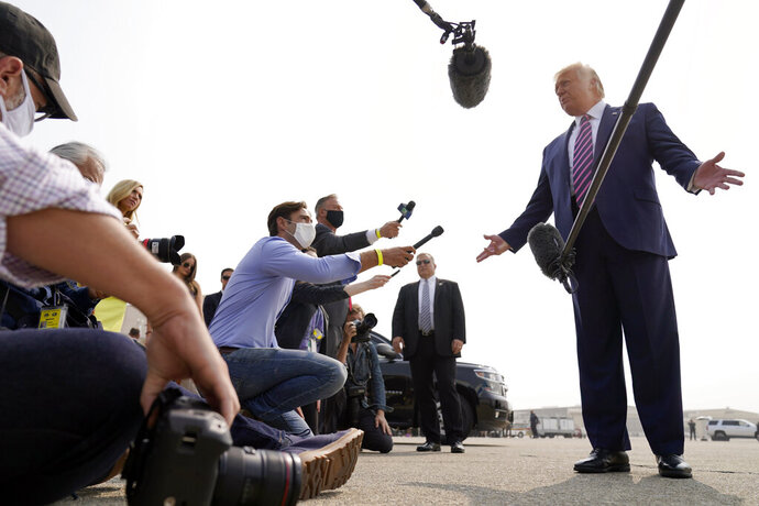 President Donald Trump speaks to reporters as he arrives at Sacramento McClellan Airport, in McClellan Park, Calif., Monday, Sept. 14, 2020, for a briefing on wildfires. (AP Photo/Andrew Harnik)