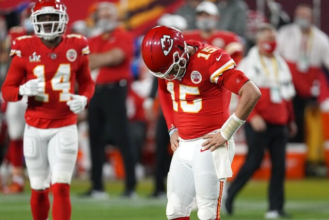 Kansas City Chiefs quarterback Patrick Mahomes (15) reacts after getting knocked down during the second half of the NFL Super Bowl 55 football game against the Tampa Bay Buccaneers Sunday, Feb. 7, 2021, in Tampa, Fla. (AP Photo/Chris O'Meara)