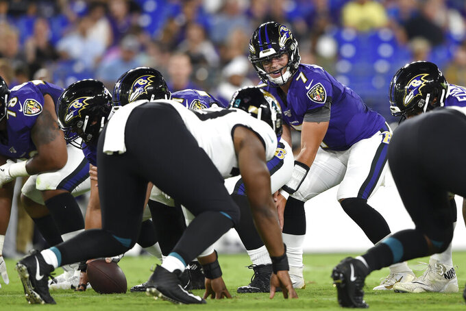 Baltimore Ravens quarterback Trace McSorley waits for the snap during the first half of the team's NFL football preseason game agains the Jacksonville Jaguars on Thursday, Aug. 8, 2019, in Baltimore. (AP Photo/Gail Burton)