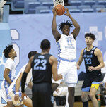 North Carolina's Day'Ron Sharpe (11) secures a defensive rebound and looks for an outlet pass during the first half against Marquette on Wednesday, February 24, 2021 at the Smith Center in Chapel Hill, N.C. (Robert Willett/The News & Observer via AP)
