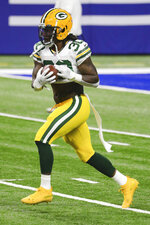 Green Bay Packers running back Jamaal Williams (30) carries the ball during warm-ups prior to an NFL game against the Indianapolis Colts, Sunday, Nov. 22, 2020 in Indianapolis. The Colts defeated the Packers 34-31. (Margaret Bowles via AP)