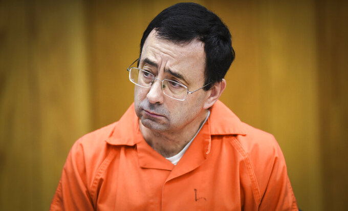Attorney slams Engler for attending game amid Nassar probe