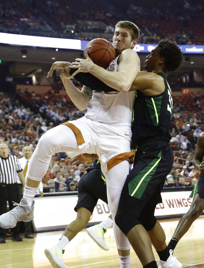Texas forward Dylan Osetkowski, left, and Baylor forward Freddie Gillespie (33) compete for control of a rebound during the first half on an NCAA college basketball game Wednesday, Feb. 6, 2019, in Austin, Texas. (AP Photo/Eric Gay)