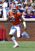 Clemson quarterback Kelly Bryant scrambles out of the pocket during the first half of an NCAA college football game against Furman, Saturday, Sept. 1, 2018, in Clemson, S.C. (AP Photo/Richard Shiro)