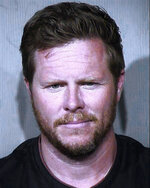 FILE - This undated booking photo provided by the Maricopa County Sheriff's Office shows County Assessor Paul Petersen. He resigned from his elected position on Tuesday, Jan. 7, 2020, months after being charged with running a human smuggling operation that paid pregnant women from the Marshall Islands to give up their babies in the U.S. (Maricopa County Sheriff's Office via AP, File)