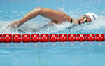 FILE - In this July 23, 2019, file photo, United States' swimmer Allison Schmitt swims in her heat of the women's 200m freestyle at the World Swimming Championships in Gwangju, South Korea. Schmitt is a graduate student at Arizona State and worked an internship last year counseling students. She's taking a break from her studies this year while attempting to qualify for a fourth Olympics appearance. Schmitt, who turns 30 on June 7, didn't initially plan on trying for one more Olympic bid. (AP Photo/Mark Schiefelbein, File)