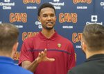 Cleveland Cavaliers first round draft selection, Evan Mobley speaks with reporters at the conclusion of a news conference at the Cavaliers training facility in Independence, Ohio, Friday, July 30, 2021. Mobley was the third selection of the draft. (AP Photo/Phil Long)