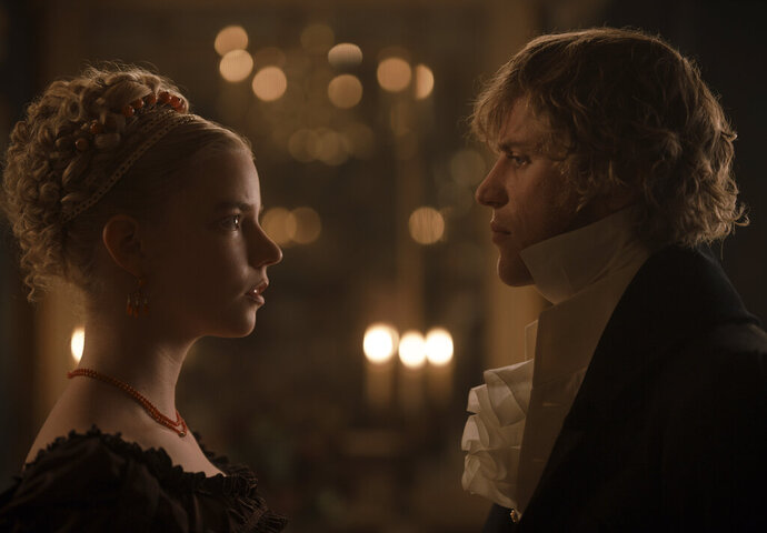 This undated image provided by Focus Features shows actors Anya Taylor-Joy, left, as Emma Woodhouse and Johnny Flynn as George Knightley in director Autumn de Wilde's film