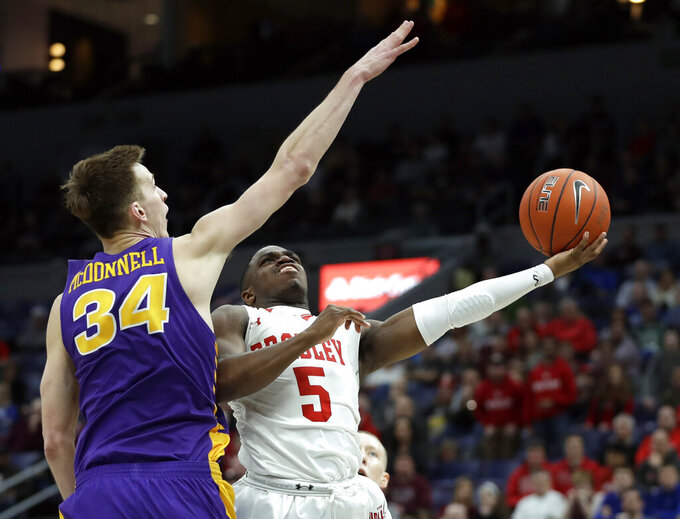 Bradley's Darrell Brown (5) heads to the basket as Northern Iowa's Luke McDonnell (34) defends during the second half of an NCAA college basketball game in the championship of the Missouri Valley Conference tournament, Sunday, March 10, 2019, in St. Louis. Bradley won 57-54. (AP Photo/Jeff Roberson)