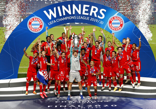 Bayern's goalkeeper Manuel Neuer lifts the trophy after Munich won the Champions League final soccer match between Paris Saint-Germain and Bayern Munich at the Luz stadium in Lisbon, Portugal, Sunday, Aug. 23, 2020.(Matthew Childs/Pool via AP)
