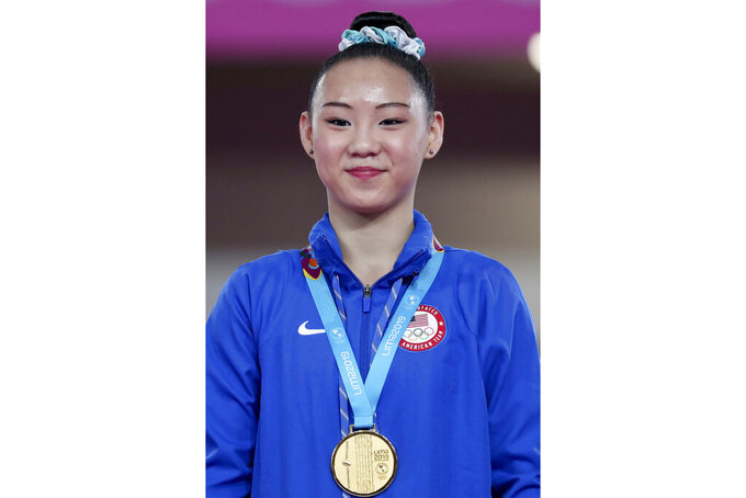 FILE - Kara Eaker of the United States stands on the podium with her gold medal after winning on the beam in the women's artistic gymnastics apparatus final at the Pan American Games in Lima, Peru, in this Wednesday, July 31, 2019, file photo. Kara Eaker, an alternate on the United States women's gymnastics team, has tested positive for COVID-19 in an Olympic training camp in Japan. Al Fong, the personal coach for both Eaker and fellow Olympic alternate Leanne Wong, confirmed the positive test in an email to The Associated Press on Monday, July 19, 2021.  (AP Photo/Fernando Vergara, File)