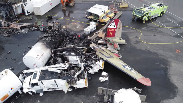 FILE - This file image taken from Oct. 3, 2019, video provided by National Transportation Safety Board shows damage from a World War II-era B-17 bomber plane that crashed on Oct. 2 at Bradley International Airport in Windsor Locks, Conn. A lawsuit was filed Tuesday, June 9, 2020, against the owners and operators of a World War II-era airplane that crashed at a Connecticut airport last October, killing seven people. (NTSB via AP, File)