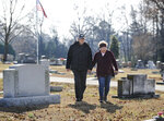 Don and Heather Collins are on a mission to find where every Morgan County resident who died in the Vietnam War is buried. In this image, they are seen on Tuesday, Dec. 3, 2019 at Decatur, Ala. City Cemetery, where two of the soldiers are buried. (Jeronimo Nisa/The Decatur Daily via AP)
