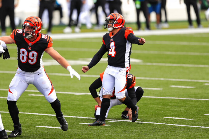 Cincinnati Bengals kicker Randy Bullock (4) kicks a field goal against the Jacksonville Jaguars from the hold of Kevin Huber in the first half of an NFL football game in Cincinnati, Sunday, Oct. 4, 2020. (AP Photo/Aaron Doster)