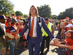 Clemson's Trevor Lawrence greets fans as he arrives for the team's CAA college football game against Georgia Tech on Thursday, Aug. 29, 2019, in Clemson, S.C. (AP Photo/Richard Shiro)