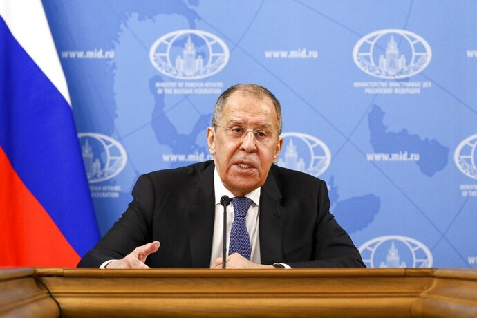 In this handout photo released by Russian Foreign Ministry Press Service, Russian Foreign Minister Sergey Lavrov speaks during his annual news conference in Moscow, Russia, Monday, Jan. 18, 2021. Lavrov said Monday the stream of reactions to Navalny's arrest by Western officials reflects an attempt