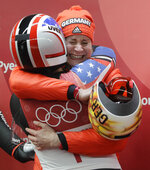 Dajana Eitberger of Germany celebrates her silver medal win the finish area with Erin Hamlin of the United States after the women's luge final at the 2018 Winter Olympics in Pyeongchang, South Korea, Tuesday, Feb. 13, 2018. (AP Photo/Wong Maye-E)
