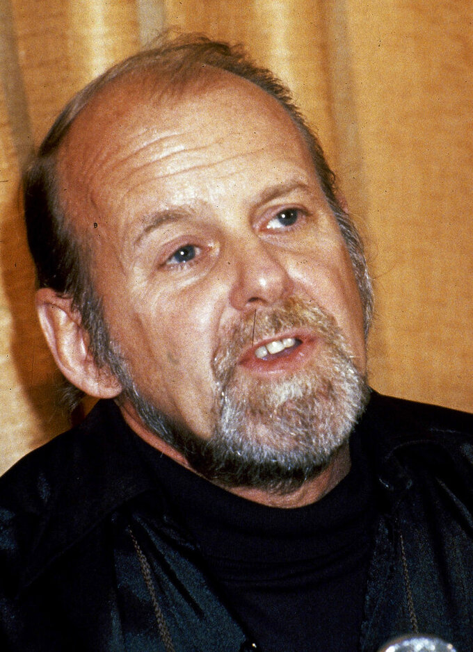 """FILE - In this 1980 file photo, director/choreographer Bob Fosse appears during a news conference at the Cannes Film Festival, at Cannes, France. A new production of Fosse's tribute to the art of dance — called """"Dancin'"""" is aiming for a Broadway bow during the 2022-23 season, according to producer Joey Parnes and Nicole Fosse, the late choreographer's daughter. (AP Photo/Jean-Jacques Levy, File)"""