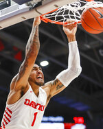 Dayton's Obi Toppin dunks during the first half of an NCAA college basketball game against St. Bonaventure, Wednesday, Jan. 22, 2020, in Dayton, Ohio. (AP Photo/John Minchillo)