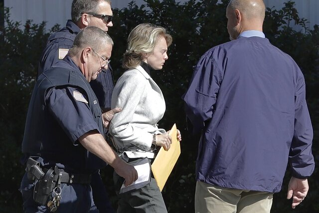 FILE - In this Sept. 19, 2019, file photo, Michelle Carter, center, arrives for a parole hearing in Natick, Mass. The state's highest court upheld Carter's 2017 involuntary manslaughter conviction in the suicide death of her despondent boyfriend, to whom she had sent insistent text messages urging him to take his own life. The state Parole Board also denied her request for early release. (AP Photo/Steven Senne, File)