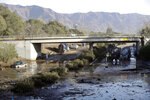 Crews work on clearing Highway 101 in the aftermath of a mudslide Saturday, Jan. 13, 2018, in Montecito, Calif. Most of the people of Montecito, a town usually known for its serenity and luxury, were under orders to stay out of town as gas and power were expected to be shut off Saturday for repairs.  (AP Photo/Marcio Jose Sanchez)