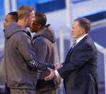 New England Patriots head coach Bill Belichick talks to Los Angeles Rams' Jared Goff during Opening Night for the NFL Super Bowl 53 football game Monday, Jan. 28, 2019, in Atlanta. (AP Photo/John Bazemore)