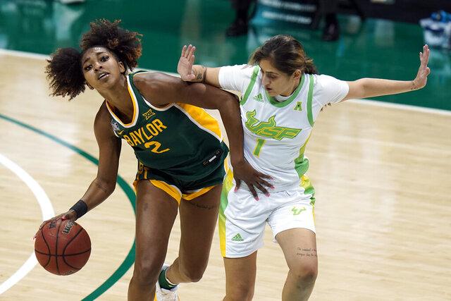 Baylor guard DiDi Richards (2) drives around South Florida guard Maria Alvarez (1) during the second half of an NCAA women's college basketball game Tuesday, Dec. 1, 2020, in Tampa, Fla. (AP Photo/Chris O'Meara)