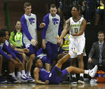 Baylor guard Mark Vital, right, reacts to his foul againstn Kansas State guard Kamau Stokes, bottom left, in the second half of an NCAA college basketball game, Saturday, Feb. 9, 2019, in Waco, Texas. (Rod Aydelotte/Waco Tribune Herald, via AP)