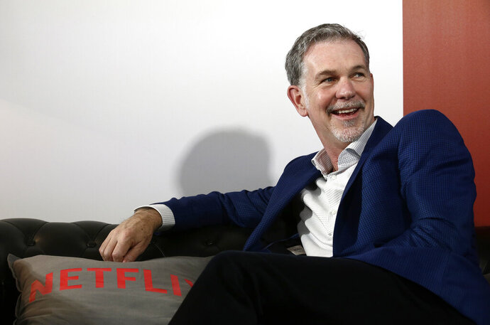 FILE - In this Feb. 28, 2017, file photo, Netflix Founder and CEO Reed Hastings smiles during an interview in Barcelona, Spain. Hastings and his wife, Patty Quillin, are donating $120 million toward student scholarships at historically black colleges and universities. (AP Photo/Manu Fernandez, File)