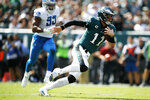 Philadelphia Eagles' Carson Wentz scrambles during the first half of an NFL football game against the Detroit Lions, Sunday, Sept. 22, 2019, in Philadelphia. (AP Photo/Matt Rourke)