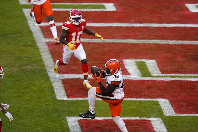 Cleveland Browns safety Karl Joseph (42) intercepts a pass in the end zone in front of Kansas City Chiefs wide receiver Tyreek Hill (10) during the second half of an NFL divisional round football game, Sunday, Jan. 17, 2021, in Kansas City. (AP Photo/Orlin Wagner)