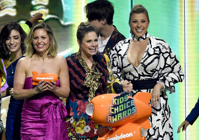 Candace Cameron-Bure, from left, Andrea Barber and Jodie Sweetin, from the cast of
