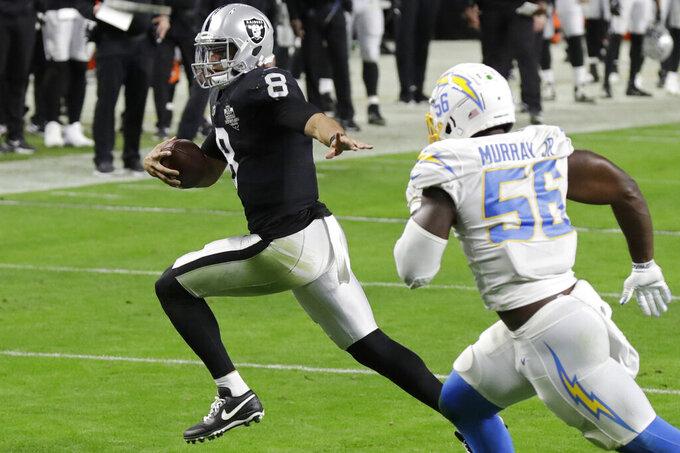 Las Vegas Raiders quarterback Marcus Mariota (8) runs for a touchdown against the Los Angeles Chargers during the second half of an NFL football game, Thursday, Dec. 17, 2020, in Las Vegas. (AP Photo/Isaac Brekken)